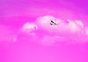 Image of plane on pink background